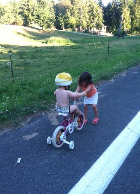 Audrey was determined to show Finn how to ride on her bike, but she pretty much ended up pulling him down the road.  Super sweet.
