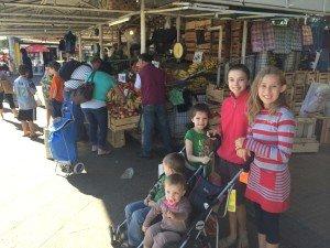 Kids waiting while Rodrigo and I picked out nectarines