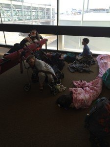 Kids sleeping on the floor, about 20 hours into our journey, at the Santiago airport